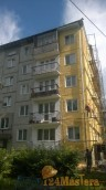 Ремонт и покраска фасада на многоквартирном жилом доме.