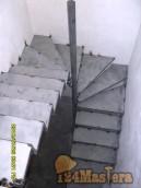 Каркас лестницы с забежными ступенями под отделку деревом.