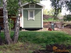 Маленький каркасный дачный домик. В скандинавской цветовой...